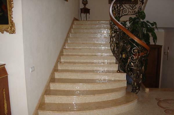 Forged railing in combination with a marble staircase perfectly fit in the interior, made in a classic style