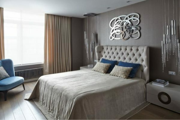 Above the headboard, you can hang a mirror panels for the effective design bedroom