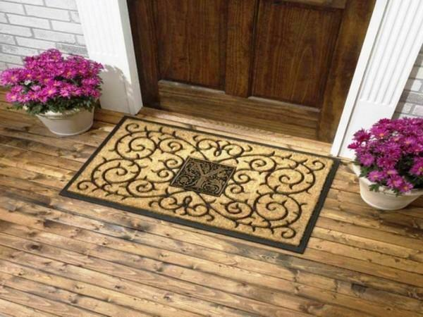 Door mat is designed to keep dirt and dust on the doorstep