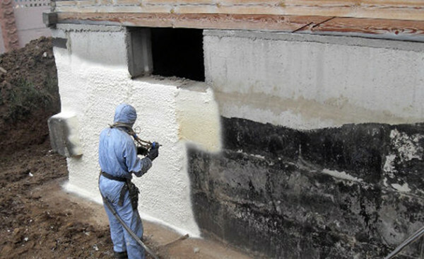 Spray polyurethane foam on the wall.