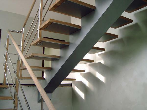 Finishing of the staircase with wood: facing of the metal frame, wooden covering of the metal frame, steps