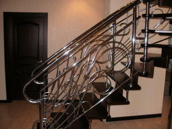 Handrails for stairs from stainless steel: metal and chrome, forged from steel for Roman, photo