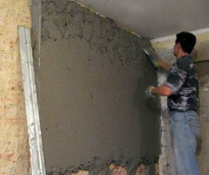 Plastering the walls with his own hands