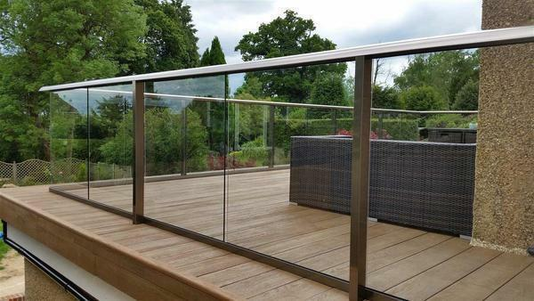 Balcony fences: railing made of metal, photo from stainless steel, wooden glass in a private house
