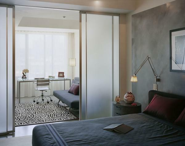 If the bedroom is planned to create a working area, you should think in advance about zoning the room