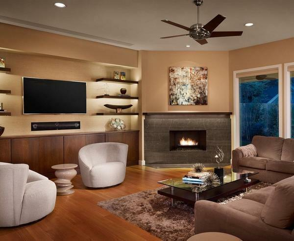 Corner fireplaces in the interior of the living room photo: hall with an electric falsh-fireplace