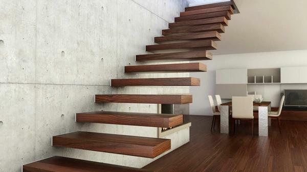 For a room made in the style of minimalism, a wooden staircase is well suited, the steps of which are fixed by glue to the wall