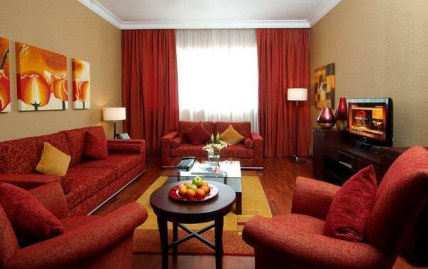 The rich red color gives the living room a luxurious appearance