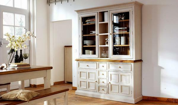 A sideboard of white color will perfectly fit into the interior of the living room in the style of Provence