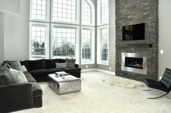 In a modern private house it will be appropriate to look a fireplace in the living room