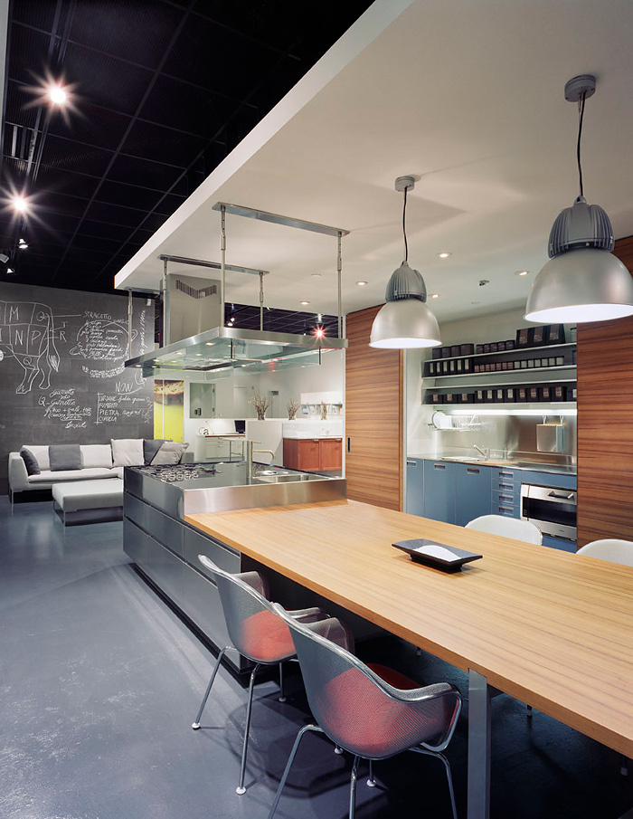 Kitchen design with ventilation ducts: the interior in a studio apartment