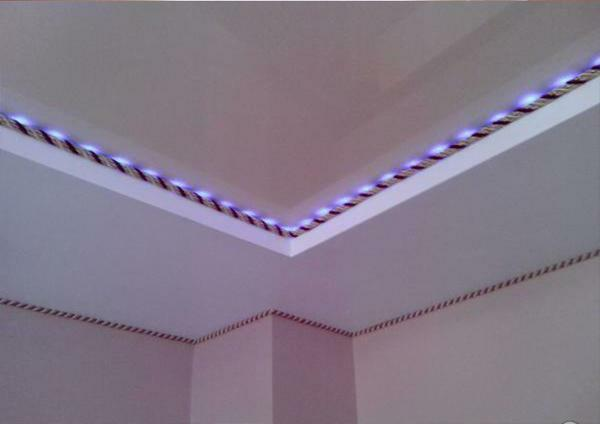 The only drawback of decorative tape is the lack of the ability to install a hidden backlight from an LED strip. When using such products, only spotlights must be installed
